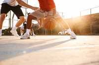 Outdoor Basketball Game Player Dribbling