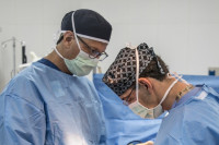 Michael Behr, MD and Peter Symbas, MD perform surgery