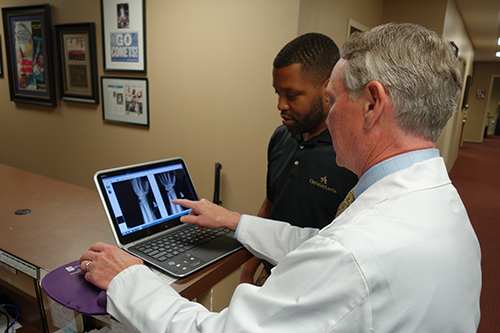 Dr. Joseph Wilkes, OrthoAtlanta and staff view X-ray