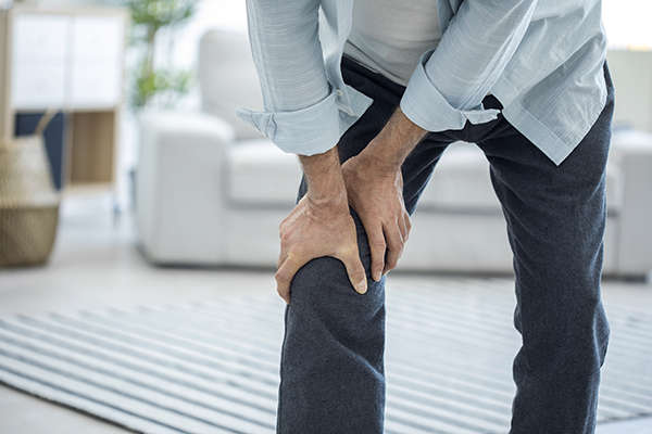 Person Standing Holding Knee
