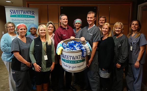 OrthoAtlanta sock donation to Sweetwater Mission