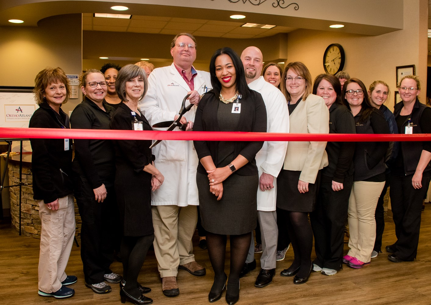 OrthoAtlanta physicians, Dr. Matthew Jaffe, Dr. Yolanda Scott and Dr. Christopher Burket and staff ribbon-cutting commemorates the remodel of the OrthoAtlanta Douglasville office.