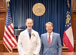 OrthoAtlanta orthopedic surgeon, Todd A. Schmidt, MD, and Governor Brian Kemp at the state capitol in Georgia