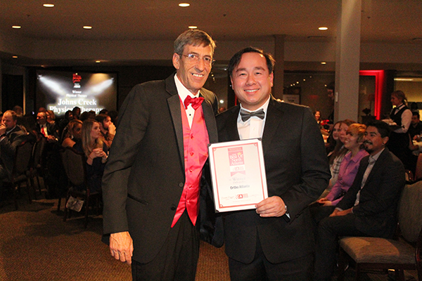 Tuan Bui, M.D., accepts award