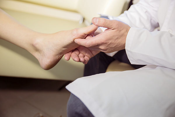 Foot Doctor with Elderly Patient